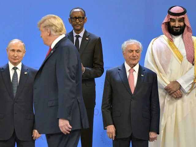 (L to R) Russia's President Vladimir Putin, US President Donald Trump, Rwandas President Paul Kagame, Brazil's President Michel Temer and Saudi Arabia's Crown Prince Mohammed bin Salman line up for a family photo, during the G20 Leaders' Summit in Buenos Aires, on November 30, 2018. - Global leaders gather in …