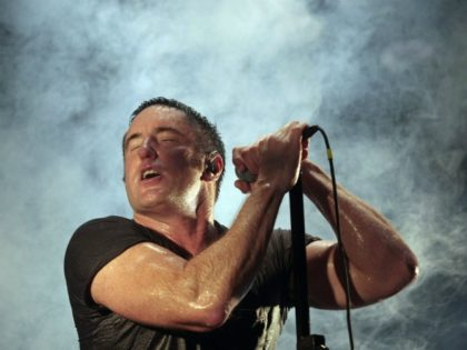 Nine Inch Nails Trent Reznor performs during the Bonnaroo Arts and Music Festival in Manchester, Tenn., Sunday, June 14, 2009. (AP Photo/Dave Martin)