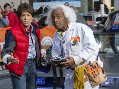 "Dylan Dreyer, dressed as Marty McFly, left, and Al Roker, dressed as Dr. Emmett Brown from ""Back to the Future"" appear during the ""Today"" show Halloween celebration at Rockefeller Plaza on Wednesday, Oct. 31, 2018, in New York. (Photo by Charles Sykes/Invision/AP)"