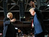 President Donald Trump opens his arms to Rush Limbaugh as he arrives to speaks during a rally at Show Me Center, Monday, Nov. 5, 2018, in Cape Girardeau, Mo.