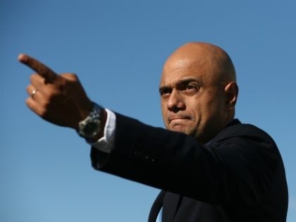 LONDON, ENGLAND - SEPTEMBER 10: Business Secretary Sajid Javid gestures after a photocall with executives from British car manufacturers on September 10, 2015 in London, England. Executives were joined by Business Secretary Sajid Javid as they stood alongside 10 of the most exciting British-built cars before they head off to …
