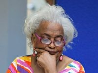 Brenda Snipes, Broward County Supervisor of Elections, looks at a ballot during a canvasing board meeting Friday, Nov. 9, 2018, in Lauderhill, Fla. The deeply purple state will learn Saturday afternoon whether there will be recounts in the bitter and tight U.S. Senate race between Republican Gov. Rick Scott and …