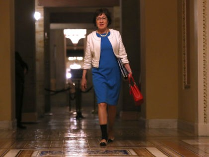 U.S. Sen. Susan Collins (R-ME) walks to the Senate chamber at the U.S. Capitol for all-night voting July 28, 2017 in Washington, DC. Senate Republicans are working to pass a stripped-down, or skinny repeal version of Obamacare reform, with repealing individual and employer mandates and the tax on medical devices …