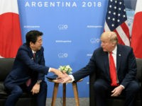 Japan's Prime Minister Shinzo Abe (L) and US President Donald Trump shake hands during a bilateral meeting in the sidelines of the G20 Leaders' Summit in Buenos Aires, on November 30, 2018. - Global leaders gather in the Argentine capital for a two-day G20 summit beginning on Friday likely to …