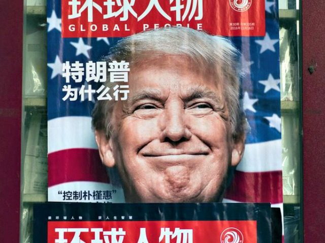This picture taken on Dec. 14, 2016, at a news stand in Shanghai shows an advertisement for a magazine featuring Donald Trump, who would soon take office as president, on the cover.