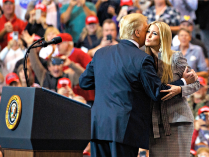 President Donald Trump greets his daughter Ivanka Trump as she arrives to speaks during a rally at the IX Center, in Cleveland, Monday, Nov. 5, 2018,