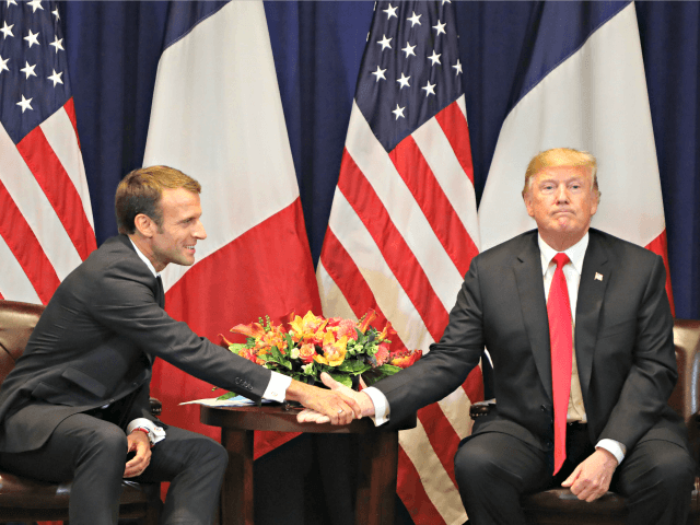 TOPSHOT - French President Emmanuel Macron (L) shakes hands with US President Donald Trump at the start of a bilateral meeting in New York on September 24, 2018, a day before the start of the General Debate of the 73rd session of the General Assembly.