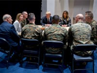 U.S. President Donald Trump, and First Lady Melania Trump listen while speaking to Marines with John Kelly, White House chief of staff, left, at Marine Barracks on November 15, 2018 in Washington, D.C. President Trump and the First Lady are meeting with Marines who responded to a building fire at …