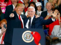 In this Nov. 3, 2018, file photo, President Donald Trump and Vice President Mike Pence wave to supporters at a rally, in Pensacola, Fla. Japan's Chief Cabinet Secretary Yoshihide Suga announced Thursday, Nov. 8, that Pence will hold talks with Prime Minister Shinzo Abe and other top officials during his …
