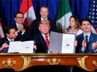 Mexico's President Enrique Pena Nieto (L) US President Donald Trump (C) and Canadian Prime Minister Justin Trudeau, sign a new free trade agreement in Buenos Aires, on November 30, 2018, on the sidelines of the G20 Leaders' Summit. - The revamped accord, called the US-Mexico-Canada Agreement (USMCA), looks a lot …