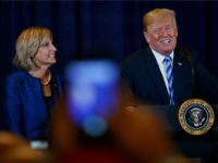President Donald Trump, joined by Rep. Claudia Tenney, R-N.Y., speaks in Utica, N.Y., Monday, Aug. 13, 2018, at a joint fundraising committee reception in Utica, N.Y. (AP Photo/Carolyn Kaster)