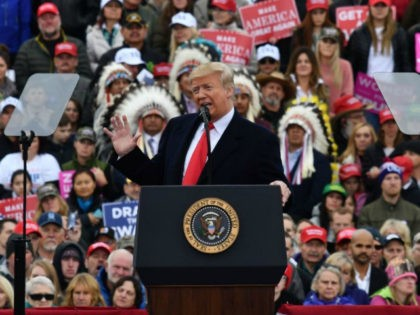 US President Donald Trump addresses a 'Make America Great Again' rally at Bozeman Yellowstone International Airport, November 3, 2018 in Belgrade, Montana. - With rallies in Montana and Florida, a state he had already visited on Wednesday, Trump on Saturday is keeping up his relentless campaign schedule before Tuesday's ballot, …