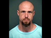 This undated booking photo released by the Tucson Police Department shows arrested man David James Bohart. Tucson police say Bohart was released from the Tucson state prison complex Monday, Nov. 19, 2018, and is accused of killing a woman the same day. Police say Bohart was arrested at a hotel …