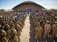 KANDAHAR, AFGHANISTAN - NOVEMBER 09: The national flag of the United Kingdom is displayed as British troops and service personal remaining in Afghanistan are joined by International Security Assistance Force (ISAF) personnel and civilians as they gather for a Remembrance Sunday service at Kandahar Airfield November 9, 2014 in Kandahar, …