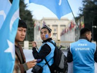 Uyghurs people demonstrate against China outside of the United Nations (UN) offices during the Universal Periodic Review of China by the UN Human Rights Council, on November 6, 2018 in Geneva. - China's mass detainment of ethnic Uighurs and its crackdown on civil liberties likely figures high on the agenda …