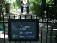 The sign indicating the 'Women Only' swimming pool is seen attached to gates on Hampstead Heath in central London on June 27, 2018. - Can transgender women swim in the women's pond in Hampstead Heath's huge London park? The regulars are divided between the desire to preserve this 'sanctuary' and …