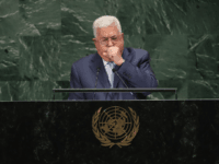 Palestinian President Mahmoud Abbas coughs during his address at the United Nations General Assembly on September 27, 2018 in New York City. World leaders gathered for the 73rd annual meeting at the UN headquarters in Manhattan. (Photo by John Moore/Getty Images)