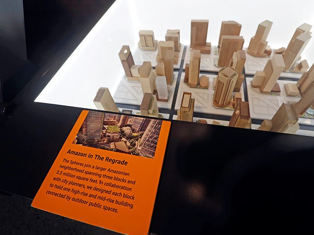 A display at Amazon's headquarters shows visitors the many buildings used by Amazon in the neighborhood, Tuesday, Nov. 13, 2018, in Seattle. Amazon, which is growing too big for its Seattle hometown, is spreading out to the East Coast. The online shopping giant ended its competition for a second headquarters …