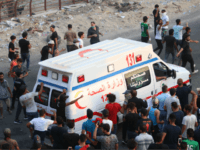 An Iraqi ambulance leaves during a protest against the government and the lack of basic services outside the regional government headquarters in the southern city of Basra on September 5, 2018. - Iraqi security forces opened fire on protesters today as the two sides clashed in the southern city of …