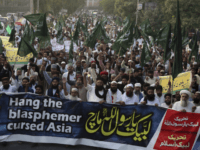 "Supporters of Pakistani radical religious Tehreek-e-Labbaik party protest against a Christian woman Asia Bibi, in Lahore, Pakistan, Friday, Oct. 19, 2018. Supporters from an extremist Islamist party have rallied to pressure judges to uphold a death sentence for a Christian woman convicted of blasphemy. Banner reads, "" O prophet of …"