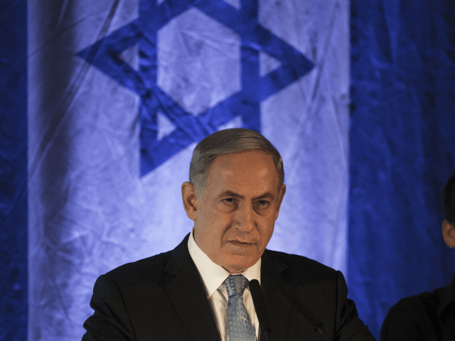 Israeli Prime Minister Benjamin Netanyahu speaks during the opening of an exhibition showcasing the 1976 Israeli commando rescue raid that freed hostages from a hijacked plane at Entebbe, Uganda, as he attends the event at the Yitzhak Rabin Center in Tel Aviv, Israel, Thursday, July 9, 2015. (AP Photo/Dan Balilty)