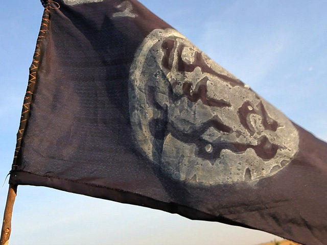 A Boko Haram flag flutters from an abandoned command post in Gamboru deserted after Chadian troops chased them from the border town on February 4, 2015. Nigerian Boko Haram fighters went on the rampage in the Cameroonian border town of Fotokol, massacring dozens of civilians and torching a mosque before …