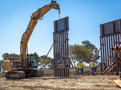 Construction workers putting up new wall at the border located at the Chula Vista Area of Responsibility, California, on June 19, 2018. Seen here is the placement of a new border wall panel. Photo by: Tim Tucciarone/Flickr
