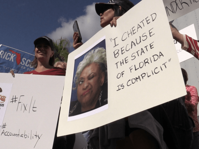 Approximately 60 protesters gathered outside Broward Supervisor of Elections Brenda Snipes' office, chanting 'lock her up,' and 'Brenda's got to go!' as the canvassing board was preparing to meet, Friday, Nov. 9, 2018.