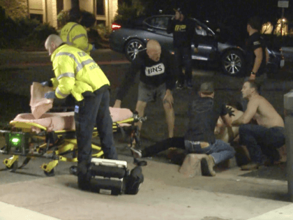 """In this image taken from video a victim is treated near the scene of a shooting, Wednesday evening, Nov. 7, 2018, in Thousand Oaks, Calif. A hooded gunman dressed entirely in black opened fire on a crowd at a country dance bar holding a weekly """"college night"""" in Southern California, …"""