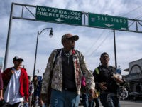 Central American migrants -mostly Hondurans- moving towards the United States in hopes of a better life, walk in Tijuana, Mexico, on November 13, 2018. - US Defence Secretary Jim Mattis said Tuesday he will visit the US-Mexico border, where thousands of active-duty soldiers have been deployed to help border police …