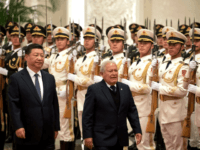 Salvadoran President Salvador Sanchez Ceren walks with Chinese President Xi Jinping during a welcome ceremony held at the Great Hall of the People in Beijing, Thursday, Nov. 1, 2018. Ceren arrived in the Chinese capital just months after the small Central American nation broke its diplomatic ties with Taiwan. (Ng …