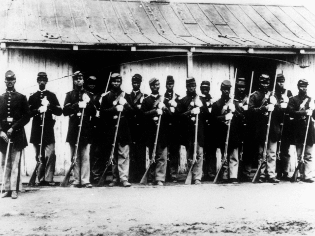ADVANCE FOR USE SATURDAY, FEB. 6, AND THEREAFTER - FILE - This is an undated 1860's file photo of a military police detachment, known as provost guards, of the 107th U.S. Colored Infantry lined up at Fort Corcoran near Washington, D.C. It's been 150 years since black soldiers from U.S. …