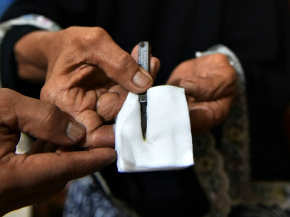 In this photograph taken on February 20, 2017, a traditional healer shows cutting tools used to circumcise women in Gorontalo, in Indonesia's Gorontalo province. Female circumcision -- also known as female genital mutilation or FGM -- has been practised for generations across Indonesia, which is the world's biggest Muslim-majority country, …