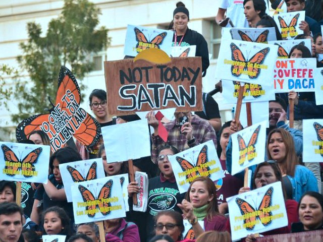Dreamers and advocates attend a rally in support of a Clean Dream Act in Los Angeles, California on March 5, 2018, the deadline for DACA recipients from the Trump administration that went into motion six months ago. / AFP PHOTO / Frederic J. BROWN (Photo credit should read FREDERIC J. …