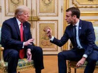 US President Donald Trump (L) speaks s with French president Emmanuel Macron prior to their meeting at the Elysee Palace in Paris, on November 10, 2018, on the sidelines of commemorations marking the 100th anniversary of the 11 November 1918 armistice, ending World War I. (Photo by Christophe Petit-Tesson / …