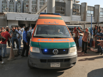 An ambulance transporting wounded Egyptians arrives at a hospital in Cairo's northern suburb of Shubra on May 26, 2017, following an attack in which 28 Coptic pilgirms were gunned down following a visit to a monastery. The assailants in three pick-up trucks attacked the bus as it carried visitors to …