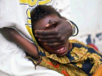 A six-year-old girl undergoes female genital mutilation in Somalia – which 95% of girls aged 4 to 11 face there. Photograph: Jean-Marc Bouju/AP