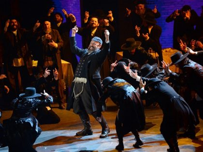 """Danny Burstein and the cast of """"Fiddler on the Roof"""" perform at the Tony Awards at the Beacon Theatre on Sunday, June 12, 2016, in New York. (Photo by Evan Agostini/Invision/AP)"""