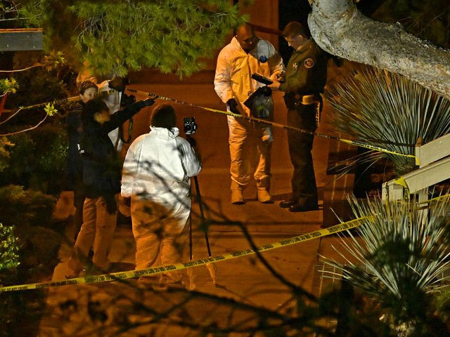 "A forensics team works the scene Thursday, Nov. 8, 2018, in Thousand Oaks, Calif. where a gunman opened fire Wednesday inside a country dance bar crowded with hundreds of people on ""college night,"" wounding 11 people including a deputy who rushed to the scene. Ventura County sheriff's spokesman says gunman …"