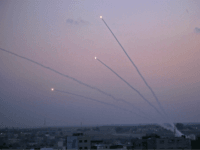 Israeli Seriously Injured as Dozens of Terror Rockets Fired from Gaza