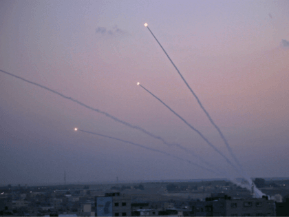 A picture taken from the Gaza Strip on November 12, 2018 shows missiles being launched toward Israel. - A number of rockets were launched from the Gaza Strip toward Israel today, AFP journalists said, while Israel's army said an Israeli bus was hit by fire from the Palestinian enclave. (Photo …
