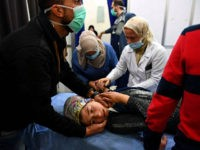 TOPSHOT - A Syrian girl receives treatment at a hospital in the regime controlled Aleppo on November 24, 2018. - Official Syrian media accused the armed opposition of launching an attack with 'toxic gas' on the northern city, but a leading rebel alliance has denied any involvement. (Photo by George …