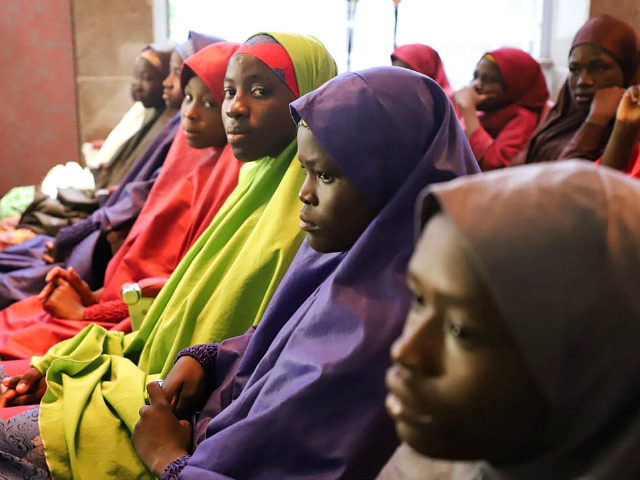 Released Nigerian school girls who were kidnapped from their school in Dapchi, in the northeastern state of Yobe, wait to meet the Nigerian president at the Presidential Villa in Abuja on March 23, 2018. The Nigerian president promised on March 23, 2018 to free the remaining Christian schoolgirl still held …