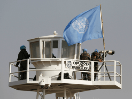United Nations peacekeepers observe the Quneitra border crossing with Syria in the Israeli annexed-Golan Heights during its reopening on October 15, 2018. - The only crossing point between Syria and Israeli-controlled territory reopened on October 15, 2018, an AFP correspondent reported, four years after closing due to the civil war …