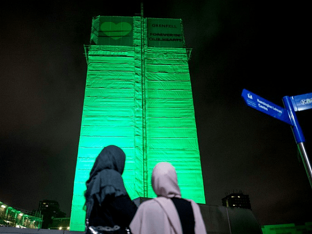 London's Grenfell Tower, where 71 people were killed in a fire a year ago, was illuminated in green © AFP Tolga Akmen