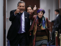 Rep. Juan Vargas (D-CA) and Rep. Rosa DeLauro (D-CT) flash thumbs up as they arrive for a Democratic caucus meeting in the U.S. Capitol Visitors Center November 14, 2018 in Washington, DC. Democrats gained 33 seats in the House of Representatives in the midterm elections so far and appear on …