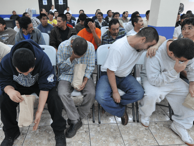 A group of 86 deported Guatemalans expelled from Paso Texas, Houston, US, wait to be registered upon arrival at the Air Force base in Guatemala City, on May 13, 2010. There are an estimated 12 million illegal migrants in the United States. AFP PHOTO/Johan ORDONEZ (Photo credit should read JOHAN …