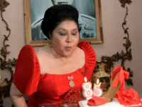 Philippine former first lady and now congresswoman, Imelda Marcos blows out the candles on a cake designed with a shoe during her 85th birthday celebration in Batac town, Ilocos norte, north of Manila on July 2, 2014. Imelda Marcos, the Philippines' most famous political survivor, toasted her 85th birthday July …