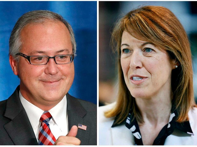 FILE - This combination of file photos shows Iowa 3rd Congressional District candidates in the November 2018 election from left, Republican incumbent Rep. David Young and Democrat Cindy Axne. (AP Photo/Charlie Neibergall, File)