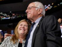 FILE- In this July 26, 2016 file photo, former Democratic presidential candidate, Sen. Bernie Sanders, I-Vt., hugs wife Jane during the second day of the Democratic National Convention in Philadelphia. A Republican lawyer pushing the allegations that Sen. Bernie Sanders' wife committed bank fraud to win a loan while president …